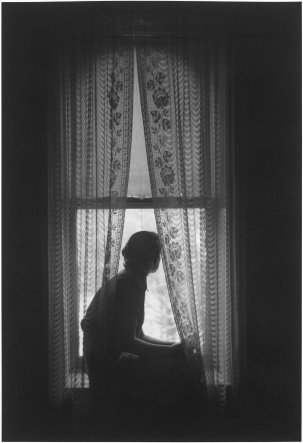 Roy DeCarava, Woman seated at window, 1953; Courtesy of The Estate of Roy DeCarava and David Zwirner.