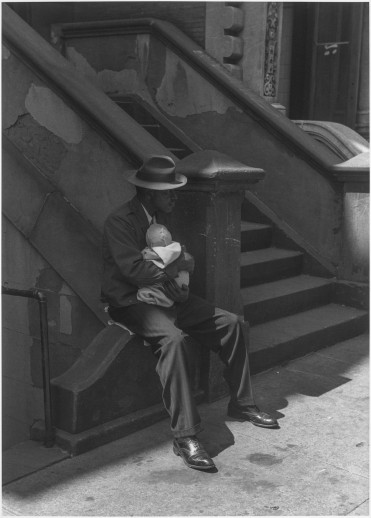 Roy DeCarava, Man sitting on stoop with baby, 1952; Courtesy of The Estate of Roy DeCarava and David Zwirner.