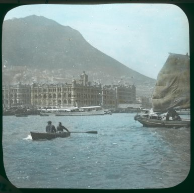 Dezső Bozóky Hong Kong Harbour: Queen's Building, Central waterfront, and Kowloon Ferry Pier 1908 Hand‐coloured glass slide H. 8 x W. 8 cm Hong Kong University Museum and Art Gallery, Hong Kong